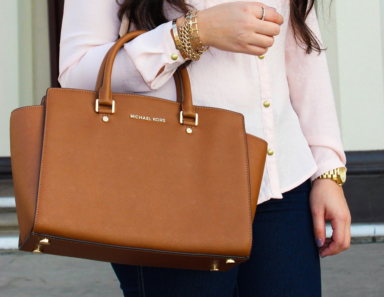 how to tell if a michael kors purse is real